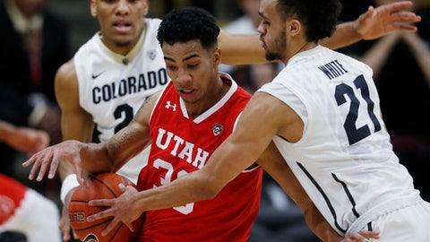 Utah guard Gabe Bealer, center, loses control of the ball as Colorado guard George King, back, and guard Derrick White defend during the second half of an NCAA college basketball game late Thursday, Feb. 23, 2017, in Boulder, Colo. (AP Photo/David Zalubowski)