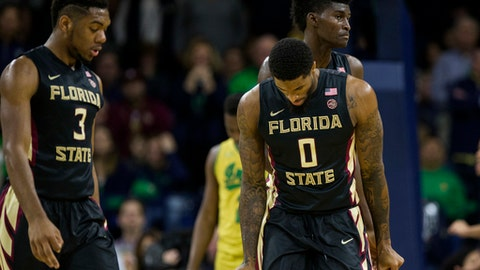 FILE - In this Feb. 11, 2017, file photo, Florida State's Phil Cofer (0), Trent Forrest (3) and Jonathan Isaac, back, show their frustration on the court during the second half of an NCAA college basketball game against Notre Dame in South Bend, Ind. If No. 19 Florida State hopes to get one of the double byes for the ACC Tournament, it will need to solve its road woes quickly. (AP Photo/Robert Franklin, File)