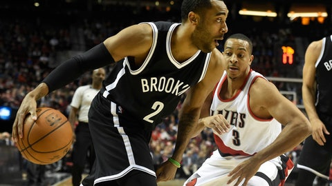 Brooklyn Nets guard Jarrett Jack (2) drives to the basket past Portland Trail Blazers guard C.J. McCollum (3) during the first half of an NBA basketball game in Portland, Ore., Tuesday, Feb. 23, 2016. (AP Photo/Steve Dykes)