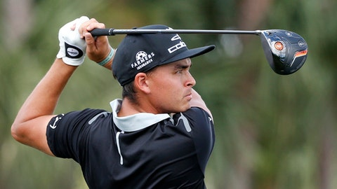 Rickie Fowler tees off on the ninth tee during the second round of the Honda Classic golf tournament, Friday, Feb. 24, 2017, in Palm Beach Gardens, Fla. (AP Photo/Wilfredo Lee)