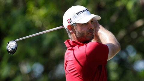 Paul Waring of England looks at his shot after teeing off on the third hole during the final round of Malaysian Open golf tournament at Kuala Lumpur Golf and Country Club in Kuala Lumpur, Malaysia, Sunday, Feb. 8,  2015. (AP Photo/Joshua Paul)