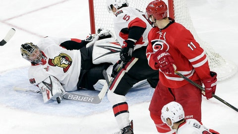 Ottawa Senators goalie Craig Anderson defends with Senators' Cody Ceci (5) as Carolina Hurricanes' Jordan Staal (11) looks back at a shot during the third period of an NHL hockey game in Raleigh, N.C., Friday, Feb. 24, 2017. Carolina won 3-0. (AP Photo/Gerry Broome)