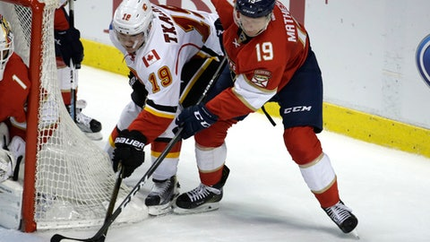 Calgary Flames left wing Matthew Tkachuk, left, and Florida Panthers defenseman Michael Matheson (19) go for the puck during the third period of an NHL hockey game, Friday, Feb. 24, 2017, in Sunrise, Fla.(AP Photo/Lynne Sladky)