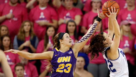 Drake guard Caitlin Ingle, right, grabs a rebound in front of Northern Iowa guard Kennedy Kirkpatrick (23) during the second half of an NCAA college basketball game, Friday, Feb. 24, 2017, in Des Moines, Iowa. (AP Photo/Charlie Neibergall)
