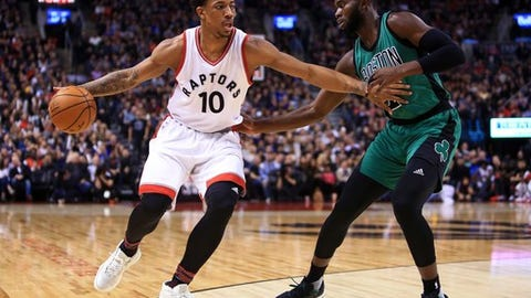 TORONTO, ON - FEBRUARY 24:  DeMar DeRozan #10 of the Toronto Raptors dribbles the ball as Jaylen Brown #7 of the Boston Celtics defends during an NBA game at Air Canada Centre on February 24, 2017 in Toronto, Canada.  NOTE TO USER: User expressly acknowledges and agrees that, by downloading and or using this photograph, User is consenting to the terms and conditions of the Getty Images License Agreement.  (Photo by Vaughn Ridley/Getty Images)