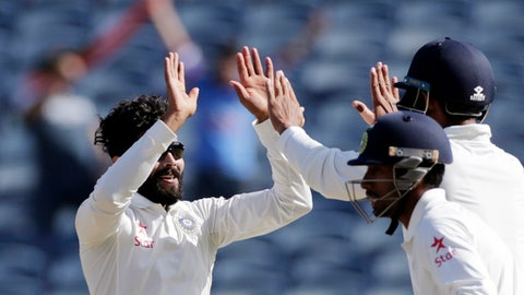 India's Ravindra Jadeja celebrates after Mitchell Marsh's wicket during third day of the first cricket test match against India in Pune, India, Saturday, Feb. 25, 2017. (AP Photo/Rajanish Kakade)