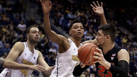 California's Ivan Rabb, center, and Kameron Rooks, left, guard Oregon State's Gligorije Rakocevic (23) during the second half of an NCAA college basketball game Friday, Feb. 24, 2017, in Berkeley, Calif. (AP Photo/Ben Margot)
