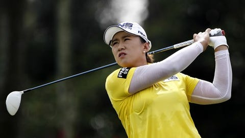 Amy Yang of South Korea follows her shot on the second hole during the third round of the LPGA golf tournament at Tournament Players Club in Kuala Lumpur, Malaysia, Saturday, Oct. 29, 2016. (AP Photo/Joshua Paul)