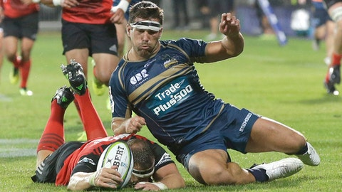 Brumbies Chris Alcock, right, and Crusaders Wyatt Crockett compete for the ball during their Super 15 rugby match in Christchurch, New Zealand, Saturday, Feb. 25, 2017. (AP Photo/Mark Baker)
