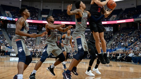 SMU's Dashawn McDowell, right, pulls down a rebound against Connecticut's Vance Jackson, second from left, as Connecticut's Christian Vital, left, and Rodney Purvis, center, defend, in the first half of an NCAA college basketball game, Saturday, Feb. 25, 2017, in Hartford, Conn. (AP Photo/Jessica Hill)