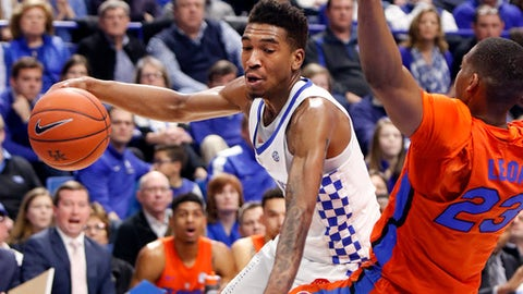Kentucky's Malik Monk, left, looks for an opening on Florida's Justin Leon during the first half of an NCAA college basketball game, Saturday, Feb. 25, 2017, in Lexington, Ky. (AP Photo/James Crisp)