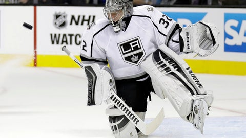 Los Angeles Kings goalie Jonathan Quick (32) stops a shot during an NHL hockey game against San Jose Sharks Wednesday, Oct. 12, 2016, in San Jose, Calif. (AP Photo/Marcio Jose Sanchez)