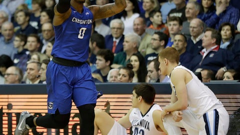 Creighton's Marcus Foster, left, reacts after making a three-pointer during the first half of an NCAA college basketball game against Villanova, Saturday, Feb. 25, 2017, in Villanova, Pa. (AP Photo/Matt Slocum)