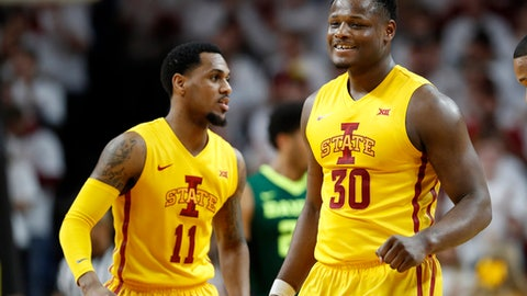 Iowa State guard Deonte Burton, right, reacts with teammate Monte Morris, left, during the first half of an NCAA college basketball game against Baylor, Saturday, Feb. 25, 2017, in Ames, Iowa. (AP Photo/Charlie Neibergall)