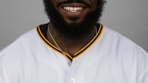 This is a 2017 photo of Josh Harrison of the Pittsburgh Pirates. Harrison knew his surgically repaired thumb was finally ready to handle the rigors of a full baseball season when it passed the Mia test. The Pittsburgh Pirates second baseman tore a ligament in his left thumb in July 2015. Surgery fixed the damage, but Harrison's hand often felt weak and stiff last season. This past winter, as he played with Mia, his 3-year-old daughter, Harrison realized he was fully recovered. (AP Photo/Matt Rourke)