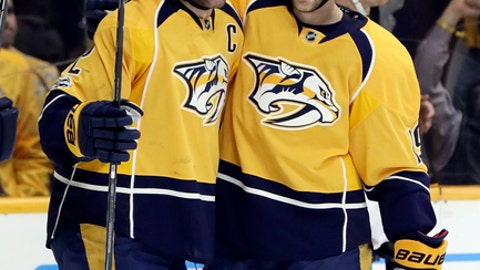 Nashville Predators center Mike Fisher (12) celebrates with center Calle Jarnkrok (19), of Sweden, after Fisher scored a goal against the Washington Capitals during the second period of an NHL hockey game Saturday, Feb. 25, 2017, in Nashville, Tenn. (AP Photo/Mark Humphrey)