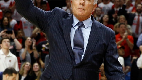 Former Maryland head coach Gary Williams acknowledges fans at a ceremony to honor his team's 15th anniversary of its NCAA title run during halftime of an NCAA college basketball game between Maryland and Iowa, Saturday, Feb. 25, 2017, in College Park, Md. (AP Photo/Patrick Semansky)