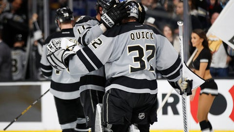Los Angeles Kings goalie Jonathan Quick, right, and Anze Kopitar, of Slovenia, celebrate their team's 4-1 win against the Anaheim Ducks in an NHL hockey game Saturday, Feb. 25, 2017, in Los Angeles. (AP Photo/Jae C. Hong)