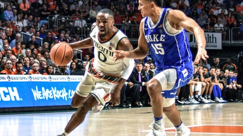 Miami guard Ja'Quan Newton drives to the basket as Duke guard Frank Jackson defends during the second half of an NCAA college basketball game in Coral Gables, Fla., Saturday, Feb. 25, 2017. Miami won 55-50. (AP Photo/Gaston De Cardenas)