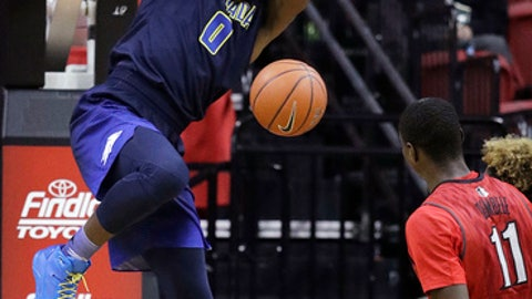 Nevada's Cameron Oliver dunks against UNLV during the second half of an NCAA college basketball game Saturday, Feb. 25, 2017, in Las Vegas. Nevada won 94-58. (AP Photo/John Locher)