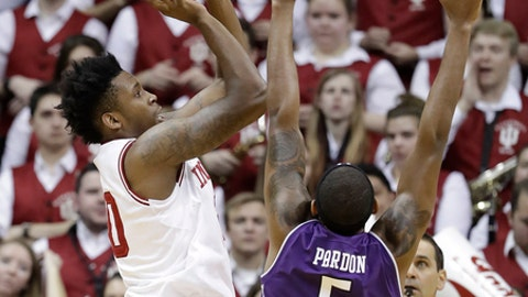Indiana's De'Ron Davis shoots over Northwestern's Dererk Pardon during the first half of an NCAA college basketball game Saturday, Feb. 25, 2017, in Bloomington, Ind. (AP Photo/Darron Cummings)