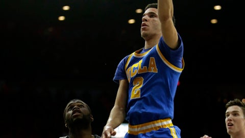 UCLA guard Lonzo Ball (2) shoots over Arizona guard Kadeem Allen during the first half of an NCAA college basketball game, Saturday, Feb. 25, 2017, in Tucson, Ariz. (AP Photo/Rick Scuteri)