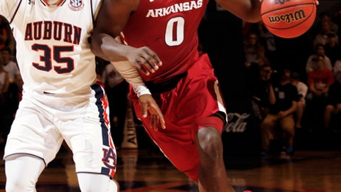 Arkansas guard Jaylen Barford (0) drives against Auburn guard Ronnie Johnson (35) during the first half of an NCAA college basketball game Saturday, Feb. 25, 2017, in Auburn, Ala. (AP Photo/Todd J. Van Emst)