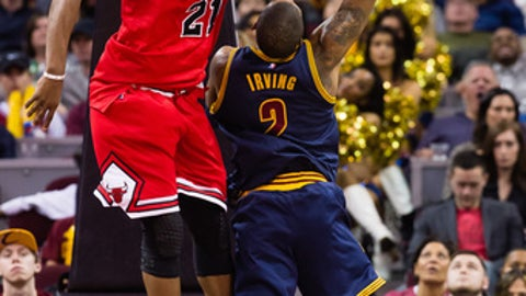 CLEVELAND, OH - FEBRUARY 25: Kyrie Irving #2 of the Cleveland Cavaliers tries to shoot over Jimmy Butler #21 of the Chicago Bulls during the second half at Quicken Loans Arena on February 25, 2017 in Cleveland, Ohio. The Bulls defeated the Cavaliers 117-99. NOTE TO USER: User expressly acknowledges and agrees that, by downloading and/or using this photograph, user is consenting to the terms and conditions of the Getty Images License Agreement. (Photo by Jason Miller/Getty Images)