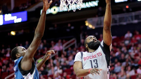 HOUSTON, TX - FEBRUARY 25:  James Harden #13 of the Houston Rockets drives past Gorgui Dieng #5 of the Minnesota Timberwolves for a layup in the first half at the Toyota Center on February 25, 2017 in Houston, Texas.  NOTE TO USER: User expressly acknowledges and agrees that, by downloading and/or using this photograph, user is consenting to the terms and conditions of the Getty Images License Agreement.  (Photo by Bob Levey/Getty Images)
