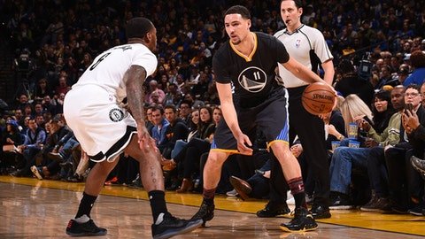 OAKLAND, CA - FEBRUARY 25:  Klay Thompson #11 of the Golden State Warriors; handles the ball against the Brooklyn Nets on February 25, 2017 at ORACLE Arena in Oakland, California. NOTE TO USER: User expressly acknowledges and agrees that, by downloading and or using this photograph, user is consenting to the terms and conditions of Getty Images License Agreement. Mandatory Copyright Notice: Copyright 2017 NBAE (Photo by Noah Graham/NBAE via Getty Images)