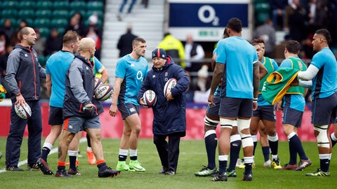 England's head coach Eddie Jones, center, speaks to his players before the Six Nations rugby union match between England and Italy at Twickenham stadium in London, Sunday, Feb. 26, 2017. (AP Photo/Alastair Grant)