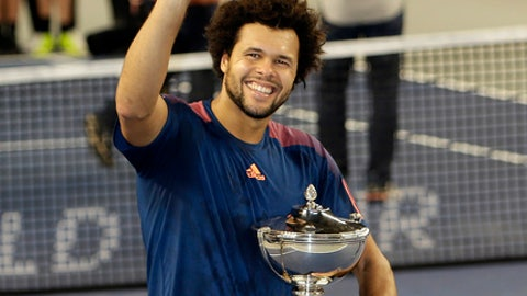 Jo-Wilfried Tsonga of France celebrates after defeating Lucas Pouille of France, during their final match at the Open 13 Provence tennis tournament in Marseille, southern France, Sunday Feb.26, 2017.(AP Photo/Claude Paris)