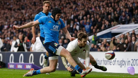 Italy's Carlo Canna kicks the ball away from England's Elliot Daly during the Six Nations rugby union match between England and Italy at Twickenham stadium in London, Sunday, Feb. 26, 2017. (AP Photo/Alastair Grant)