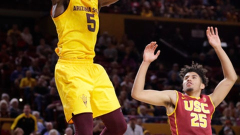 Arizona State forward Obinna Oleka (5) dunks as USC forward Bennie Boatwright (25) defends during the second half of an NCAA college basketball game, Sunday, Feb. 26, 2017, in Tempe, Ariz. (AP Photo/Matt York)