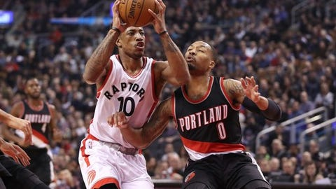 TORONTO, ON - FEBRUARY 26: DeMar DeRozan #10 of the Toronto Raptors goes to the basket against Damian Lillard #0 of the Portland Trail Blazers during NBA game action at Air Canada Centre on February 26, 2017 in Toronto, Canada. (Photo by Tom Szczerbowski/Getty Images) NOTE TO USER: User expressly acknowledges and agrees that, by downloading and or using this photograph, User is consenting to the terms and conditions of the Getty Images License Agreement. (Photo by Tom Szczerbowski/Getty Images)