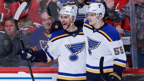 St. Louis Blues defenseman Alex Pietrangelo, left, celebrates with defenseman Colton Parayko, right, after scoring against the Chicago Blackhawks during the second period of an NHL hockey game, Sunday, Feb. 26, 2017, in Chicago. (AP Photo/Kamil Krzaczynski)