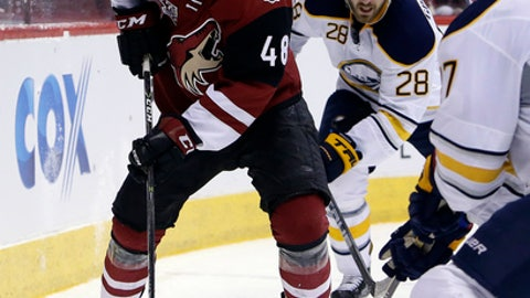 Arizona Coyotes left wing Jordan Martinook (48) skates away from Buffalo Sabres center Zemgus Girgensons (28) in the second period during an NHL hockey game, Sunday, Feb. 26, 2017, in Glendale, Ariz. (AP Photo/Rick Scuteri)