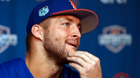 New York Mets outfielder and former NFL quarterback Tim Tebow listens to a reporters question during a news conference at the baseball teams spring training facility in Port St. Lucie, Fla., Monday, Feb. 27, 2017. (AP Photo/John Bazemore)