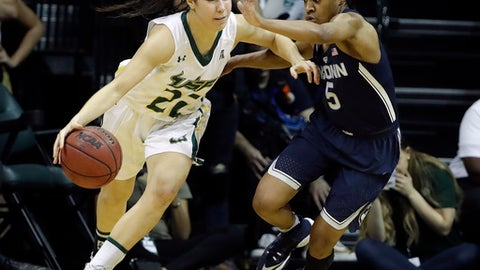 South Florida guard Laia Flores (22) drives past Connecticut guard Crystal Dangerfield (5) during the second half of an NCAA women's college basketball game, Monday, Feb. 27, 2017, in Tampa, Fla. UConn won the game 96-68. (AP Photo/Chris O'Meara)