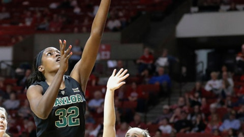 Baylor forward/center Beatrice Mompremier (32) goes up for basket in front of Oklahoma guard Gabbi Ortiz (21) during the first half of an NCAA college basketball game in Norman, Okla., Monday, Feb. 27, 2017. (AP Photo/Alonzo Adams)