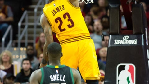 CLEVELAND, OH - FEBRUARY 27: LeBron James #23 of the Cleveland Cavaliers dunks over Tony Snell #21 of the Milwaukee Bucks during the first half at Quicken Loans Arena on February 27, 2017 in Cleveland, Ohio. NOTE TO USER: User expressly acknowledges and agrees that, by downloading and/or using this photograph, user is consenting to the terms and conditions of the Getty Images License Agreement. (Photo by Jason Miller/Getty Images)