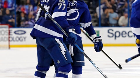 Tampa Bay Lightning's Victor Hedman (77) congratulates Nikita Kucherov (86), of Russia, on his third goal of the second period of an NHL hockey game Monday, Feb. 27, 2017, in Tampa, Fla. (AP Photo/Mike Carlson)
