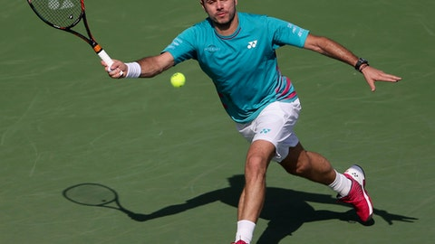 Stan Wawrinka of Switzerland returns the ball to Damir Dzumhur of Bosnia-Herzegovina during the Dubai Tennis Championships, in Dubai, United Arab Emirates, Tuesday, Feb. 28, 2017. (AP Photo/Kamran Jebreili)