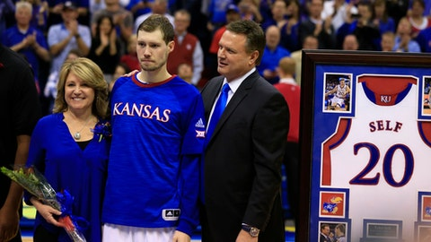 Kansas guard Tyler Self is flanked by his father, coach Bill Self and his mother, Cindy, during Senior Night introductions before an NCAA college basketball game against Oklahoma in Lawrence, Kan., Monday, Feb. 27, 2017. It's hard for coaches in any sport to pick favorite players. Usually, they will say they love them all like their own sons or daughters. But for Kansas coach Bill Self, there was never any question: His own son, Tyler, will go down as his favorite Jayhawk. (AP Photo/Orlin Wagner)