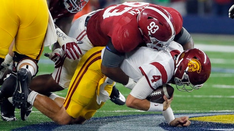 FILE - In a Saturday, Sept. 3, 2016, file photo, Southern California quarterback Max Browne (4) is sacked for a 5-yard loss by Alabama defensive lineman Jonathan Allen during the first half of an NCAA college football game, in Arlington, Texas. Allen's NFL resume already includes awards, championship rings and four years of production at Alabama. Now, the former Crimson Tide defensive lineman is preparing to add his 40 time, vertical jump and other measurables at the scouting combine this week in Indianapolis.  (AP Photo/Tony Gutierrez, File)