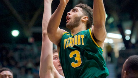 FILE - In this Dec. 21, 2016, file photo, Vermont forward Anthony Lamb (3) drives the ball through the Butler defense to put up a shot in the first half of an NCAA college basketball game in Indianapolis. The longest winning streak in the 117-year history of Vermont basketball, 18 games, is now the longest current winning streak in all of NCAA Division I. The Catamounts (26-5) took over the top spot Saturday night, Feb. 25, 2017, after then top-ranked Gonzaga (29-1) lost to BYU. (AP Photo/Doug McSchooler, File)