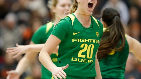 In this Jan. 29, 2017 photo, Oregon's Sabrina Ionescu yells as she comes to the bench during an NCAA college basketball game against Oregon State in Corvallis, Ore. With four triple-doubles this season, Oregon's 5-foot-10 guard is a driving force behind the Ducks' shot at making the NCAA Tournament for the first time since 2005. (Andy Nelson/The Register-Guard via AP)