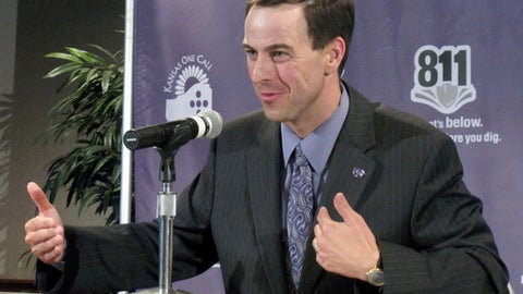 FILE - In this June 16, 2010, file photo, Kansas State athletic director John Currie answers reporters' questions about the future of the Big 12 in Manhattan, Kan. Tennessee announced Tuesday, Feb. 28, 2017, that they hired Currie from Kansas State to replace Dave Hart as the Volunteers' athletic director. (AP Photo/John Hanna, File)