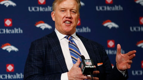 FILE- In this Jan. 12, 2017, file photo, Denver Broncos general manager John Elway responds to questions during a news conference at the team's headquarters in Englewood, Colo. The NFL is considering making referees full-time employees and centralizing replay review at its New York headquarters as it aims for more consistent, shorter games, Tuesday, Feb. 28, 2017.  The NFL is considering making referees full-time employees and centralizing replay review at its New York headquarters as it aims for more consistent, shorter games, Tuesday, Feb. 28, 2017. Elway, a member of the competition committee, said the caveat is that these referees have successful careers outside of football and they may not want to give up their day jobs. (AP Photo/David Zalubowski, File)