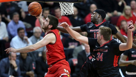 Maryland forward Ivan Bender shoots as Rutgers center C.J. Gettys, right, defends during the first half of an NCAA college basketball game Tuesday, Feb. 28, 2017, in Piscataway, N.J. (AP Photo/Mel Evans)